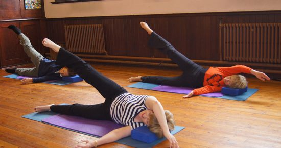 Pilates class with Diana, Northampton. People conducting Pilates mat exercises