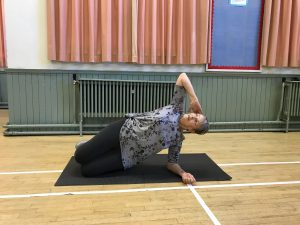 Picture of Diana demonstrating Pilates position